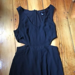 Black romper with cut out sides, hardly worn